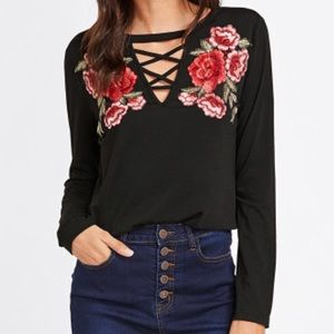 Embroidered Crisscross V-Neck Top.